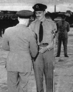 "...and yet, at the same awards ceremony in Dorval, Quebec, Captain-Navigator Don McVicar, a civilian pilot, had to wear his Air Observer School cap with a Ferry Command badge that read only ""FC"" and khaki clothing that was the only ""uniform"" he was issued! Here he is receiving his King's Commendation from Air Chief Marshal Sir Frederick Bowhill for his ""valuable services in the air."""