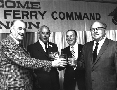 "Don McVicar, D.C.T. Bennett, ""Punch"" Dickens and ""Taffy"" Powell, skilled pilots and aviation heroes, share a toast at the 1980 Ferry Command reunion in Dorval, Quebec."