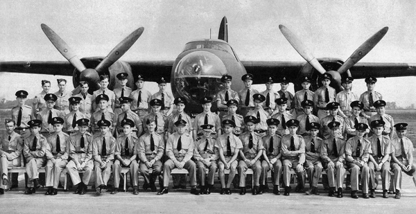 This picture of Ferry Command aircrew in 1942 at Dorval was taken before the departure of ten B-26 Marauders for the RAF across the South Atlantic ferry route to the Near East. Wing Commander John Adams, DFC, AFC from the Royal New Zealand Air Force, is the large man in the center, sitting next to RAFFC Commander-in-Chief, Air Chief Marshal Sir Frederick Bowhill GBE, KCB, CMG, DSO.