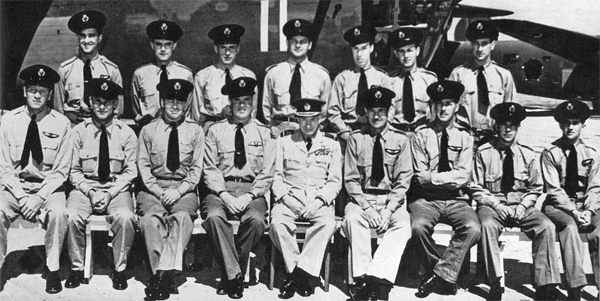 Some of the RAFFC aircrew assigned to the fourteen Liberators which flew much-needed ammunition to Montgomery's Eighth Army in Africa: Back row, standing, L-R, M. Farr, D. Sharpe, D. Ewart, D. Woodard, J.R. Shreve, L.A. Tanner, G. McPherson. Front row, seated, L-R: B.M. Merrill, G. Bliss, Capt. G.A. Hersam, W.J. Davidson, Sir Frederick Bowhill, R.M. Lloyd, A.B. Watt, Cooke, Davidson.