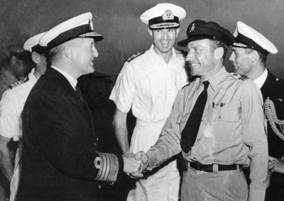 RAFFC Captain Don Teel shakes hands with Admiral Sir Bruce Fraser, Commander of the British Pacific Fleet, in 1944.