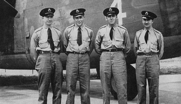 Ferry Command aircrew, L-R: W.C Harris, Capt. Jack Parkinson, Capt. J. Bradley, Gorman, probably in front of Liberator FK243, which they flew to the Middle East theatre in the summer of 1942 to supply Gen. Montgomery's Eighth Army with ammunition.
